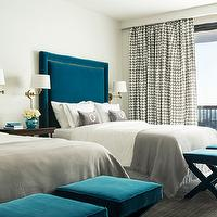 Tobi Fairley - bedrooms - teal x-bench, x-bench, teal ottomans, velvet ottomans, gingham curtains, gray gingham curtains, gray blankets, chic bedroom, peacock blue bedroom, peacock blue, peacock blue headboard, velvet headboard, nailhead trim headboard, blue velvet headboard, peacock blue velvet headboard, brass sconce, swing-arm sconce, brass swing-arm sconce, gray lumbar pillow, velvet pillows, gray velvet pillow, teal bedrooms, chic teal bedrooms, peacock blue ottomans,