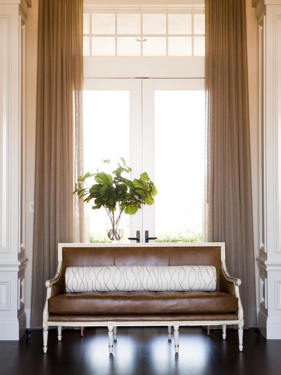 Alice Lane Home - living rooms - formal sitting area, French doors, transom windows, French settee, French sofa, leather settee, leather sofa, caramel leather sofa, bolster pillows, ebony hardwood floors, cream woodwork,