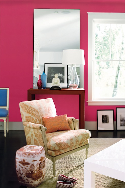 Kansas City Homes & Gardens - living rooms - Benjamin Moore - Peony - pink living room, pink paint, neon pink, paint, French chair, bergere chair, white parsons coffee table, parsons table, cobalt blue, cobalt blue chair, square back chair, cobalt blue square back chair, chinoiserie garden stool, jute rug, red console tgable, red parsons console table, buddha, hot pink paint colors, hot pink wall paint, hot pink walls, hot pink paint, hot pink paint color,