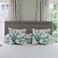 Rachel Reider Interiors - bedrooms - headboard nailhead trim, gray headboard nailhead trim, sage green paint, sage green walls, bed in front of windows, gray headboard, gray linen headboard, turquoise blue coral pillows, coral pillows, black pedestal tables, grommet drapes, blue glass lamps, geometric window panels, geometric grommet drapes, patterned curtains, studded headboard, gray studded headboard, gray and blue bedroom, blue and gray bedroom, black throw, blue glass lamps, blue table lamps,