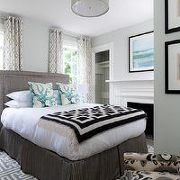 Rachel Reider Interiors - bedrooms - sage green paint, sage green walls, bed in front of windows, fretwork rug, blue fretwork rug, gray headboard, gray linen headboard, black and white, black and white throw, turquoise blue coral pillows, coral pillows, black pedestal table, grommet drapes, ikat chair, gray bed skirt, blue glass lamp, geometric window panels, geometric grommet drapes, patterned curtains, gray and blue bedroom, blue and gray bedroom, black throw, , Grecian Maze Dhurrie Rug, Jonathan Adler Richard Nixon Throw,