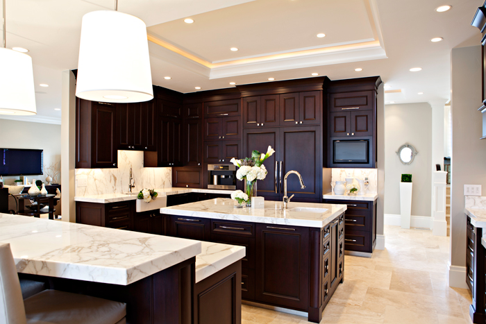 Medium brown cabinets with white quartz countertop for Kitchen designs with espresso cabinets