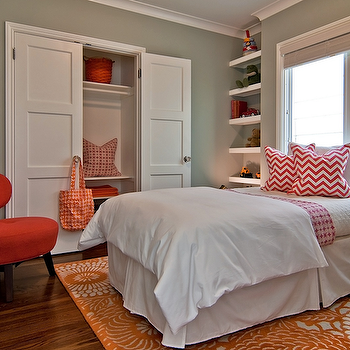 Tamara Mack Design - girl's rooms - fun girl's bedroom, sage green bedroom, sage green paint, sage green walls, persimmon chair, modern chair, orange rug, patterned rug, orange patterned rug, coral pillows, chevron pillows, coral chevron pillows, zigzag pillows, white floating shelves, red and orange girls room, red and orange girls bedroom,