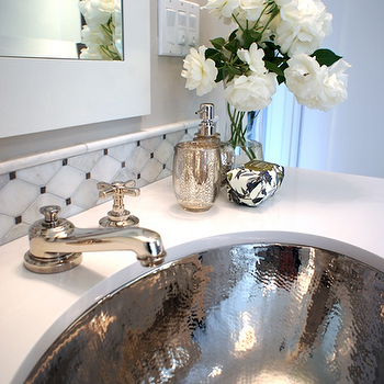 Tamara Mack Design - bathrooms - hammered sink, hammered bathroom sink, mercury glass tumbler, mercury glass vase, marble tile backsplash, marble backsplash, white framed mirror, chic bathroom, elegant bathroom, oval sink, mercury glass bathroom accents, mercury glass, hammered metal sink,