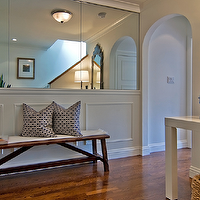 Tamara Mack Design - entrances/foyers - mirrored walls, wainscoting, wainscoting walls, rustic bench, ginger jar, Chinese ginger jar, arched doorway, foyer wainscoting,