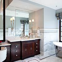 Elizabeth Kimberly Design - bathrooms - glam bathroom, glamorous bathroom, gray paint color, espresso bathroom cabinets, inset cabinets, espresso inset cabinets, calcutta marble, calcutta marble countertops, drop-down vanity, bridge faucets, barrel back chair, vanity chair, marble backsplash, mosaic inset tiles, bathroom sconces, marble floor, monogrammed towels, oval sinks, freestanding tub, espresso cabinets, espresso vanity, espresso bathroom vanity, espresso double vanity, Waterworks Candide Freestanding Oval Cast Iron Bathtub,