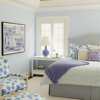 Amanda Nisbet Design - bedrooms - purple and gray bedroom, blue bedroom, blue paint, blue walls, vaulted ceiling, gray headboard, camelback headboard, gray camelback headboard, purple lamp, purple gourd lamp, purple ikat pillow, white nightstand, white chinoiserie table, gray bed skirt, spool chair, spool ottoman,