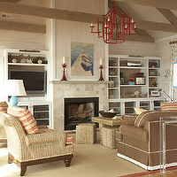 Amanda Nisbet Design - living rooms - seaside living room, vaulted ceiling, red chandelier, chinoiserie chandelier, red pagoda chandelier, fireplace, seagrass chairs, blue gourd lamp, bound sisal rug, built-ins, flatscreen TV nook, flatscreen niche, lucite console table, acrylic console table, chocolate brown sofa, white piping, seagrass cube ottomans, seagrass coffee table, wood plank walls, wood panel walls, fireplace built-ins, pagoda chandelier, red pagoda chandelier, chinoiserie chandelier, red chinoiserie chandelier,