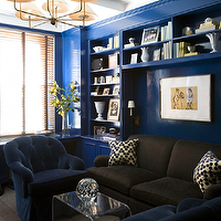 Amanda Nisbet Design - dens/libraries/offices - cobalt blue, glossy blue walls, cobalt blue walls, cobalt blue paint, dark brown sofa, blue velvet chairs, blue chairs, blue tufted chairs, blue velvet tufted chairs, coffee table, acrylic, coffee table, chevron pillows, brass chandelier, brass sconces, built-ins, blue built-ins, acrylic coffee table, waterfall coffee table, acrylic waterfall coffee table, Plexi-Craft Waterfall Cocktail Table,