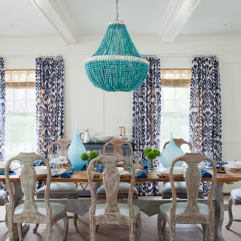 Amanda Nisbet Design - dining rooms: seaside dining room, beachy dining room, beaded chandedlier, turquoise blue beaded chandelier, white box beams, wainscoting, white wainscoting, matchstick shades, trestle dining table, gray washed dining chairs, vintage dining chairs, dining chairs, blue vases, blue bottles, ikat curtains, ikat curtains, ikat drapes, ikat window panels, ikat window treatments, purple ikat curtains, purple ikat drapes, purple ikat window panels, purple ikat window treatments, purple curtains, purple drapes, purple window panels, purple window treatments, white and purple curtains, white and purple drapes, white and purple window panels, white and purple ikat curtains, white and purple ikat drapes, white and purple ikat window panels,