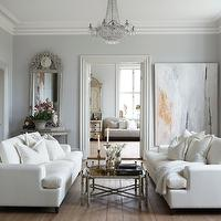 Slettvoll - living rooms - gray living room, swedish living room, white sofas, white modern sofas, modern sofas, abstract art, crystal chandelier, half moon console table, white and gray living room, white and grey living room,