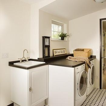 Classic Homeworks - laundry/mud rooms - black and white, black and white laundry room, vintage tiles, black door moldings, black moldings, utility sink, black countertop,