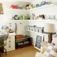 BHG - dens/libraries/offices: fun office, white floating shelves, corner desk, beadboard walls, white beadboard, vintage locker baskets, yellow wingback chair, wingback chair, stripe chair, checkered pillow, driftwood lamp, seagrass rug, numbered canisters, vintage hooks, vintage crates, home office shelving, home office shelves, floating shelves, L shaped shelves,