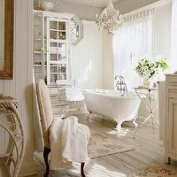 BHG - bathrooms - beadboard, white beadboard ceiling, beadboard walls, clawfoot tub, plank wood floors, tripod table, area rugs, glass-front cabinet, crystal chandelier, bathroom lighting, hex window, vintage washstand, vintage vanity, shabby chic, shabby chic bathroom, shabby chic master bath, shabby chic master bathroom,