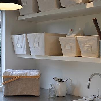 Remodelista - laundry/mud rooms - modern pendant, floating shelves, white floating shelves, utility sink, canvas bins, stainless steel countertops, laundry shelves, laundry room shelves, laundry room shelving, laundry room shelf, laundry room, Cecilie Manz Caravaggio Pendant, The Container Store Open Canvas Bin,