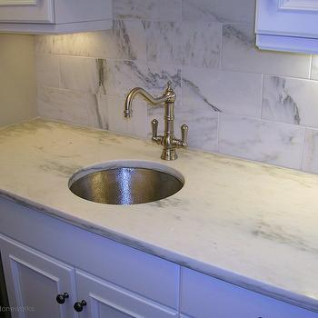 Precision Stoneworks - bathrooms - butlers pantry, stainless steel wine cooler, raised panel cabinets, white raised panel cabinets, marble countertops, white marble countertops, hammered sink, round hammered sink, brushed nickel faucet, marble subway tiles, marble subway tile backsplash, hammered metal sink,