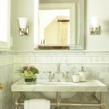 Precision Stoneworks - bathrooms - marble washstand, 2-leg washstand, white carrara marble, white carrara marble subway tiles, white carrara marble subway tile backsplash, polished nickel sconces, beveled mirror, inset tiles, marble inset tiles,