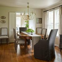 Marianne Simon Design - dining rooms - bi-fold doors, tan paint, tan walls, beaded chandelier, oval dining table, captain chairs, captain dining chairs, gray captain chairs, gray slipcover chairs, brass chandelier, dining room chandelier, French dining chairs, square back dining chairs, french dining room chairs, Restoration Hardware Vintage French Square Back Dining Chair, Pottery Barn Linen Hemstitch Table Runner, Marigot Six-Light Chandelier With Seeded Glass Beads,
