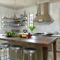 Christopher Architects - kitchens - gray kitchen, gray kitchen cabinets, gray cabinets, farmhouse sink, instant hot water faucet, white carrara marble, white carrara marble countertops, white carrara marble subway tiles, white carrara marble subway tile backsplash, backsplash, stainless steel appliances, kitchen hood, island pendants, butcher block, butcher block countertop, butcher block kitchen island, stainless steel shelves, stainless steel floating shelves, Crate & Barrel Spin Barstool,