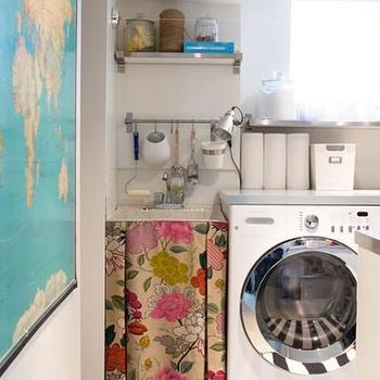 House & Home - laundry/mud rooms - whimsical laundry room, vintage laundry room, world map, white and black rug, white and black stripe rug, awning stripe rug, skirted sink, white front-load washer and dryer, basement laundry room, skirted sink, skirted laundry sink,