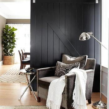Urrutia Design - living rooms - Benjamin Moore - Black - barn door, velvet chair, charcoal gray chair, tripod table, pharmacy floor lamp, black barn door, black door, living room, family room, sliding barn door, black sliding barn door, gray velvet chair, rolling door, wall mounted door, contemporary door,
