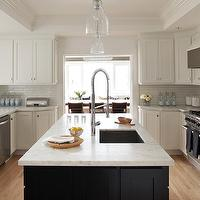 Urrutia Design - kitchens - White Carrara Marble, Subway Tile, Counter Stools, Black Cabinets, White Cabinets, Black Cabinetry, White Cabinetry, black kitchen island, two-tone kitchen, two-tone cabinets, U shaped kitchen, sink in kitchen island, island pendants, Kitchen, Black Kitchen, White Kitchen, Black White Kitchen, white carrera marble, carrera marble, carrera marble countertop, white carrera marble countertop,