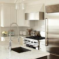 Urrutia Design - kitchens - White Carrara Marble, Subway Tile, Black Cabinets, White Cabinets, Black Cabinetry, White Cabinetry, island pendants, sink in kitchen island, black kitchen island, two-tone kitchen, two-tone cabinets, Kitchen, Black Kitchen, White Kitchen, Black White Kitchen, kitchen island sink,
