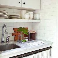 Atlanta Homes & Lifestyles - kitchens - frameless cabinets, white frameless cabinets, white floating  shelf, floating shelves, white carrara marble, white carrara marble countertops, modern faucet, skirted sink, subway tiles, subway tile backsplash, vintage kitchen, farmhouse kitchen,