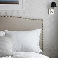 Design Sponge - bedrooms - white and silver, white and silver wallpaper, metallic wallpaper, gray headboard, camelback headboard, gray camelback headboard, headboard nailhead trim, silver nailhead trim, white hotel bedding, colette bed, upholstered bed, camelback headboard, linen camelback headboard, upholstered camelback headboard, colette bed, Graham &amp; Brown Darcy Wallpaper, Crate &amp; Barrel Colette Bed,
