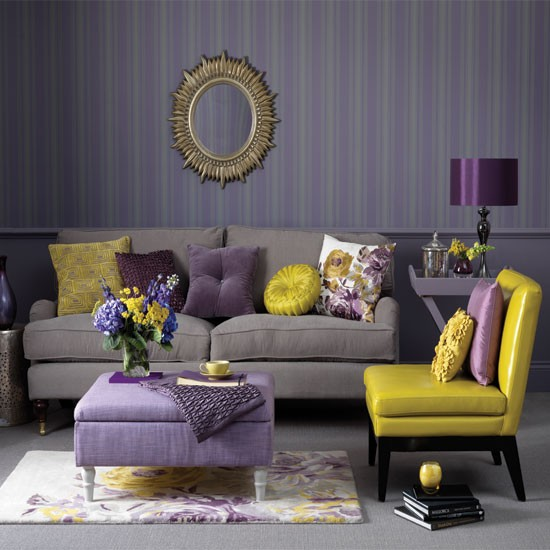 living rooms - pillows, gray and purple living room, amethyst and yellow living room, brushed gold sunburst mirror, gray velvet sofa, yellow leather, accent chair, texture ottoman, floral print rug, royal purple, gray carpeting, gray and purple stripes,