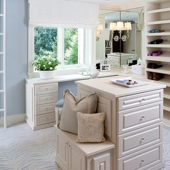 Kristin Peake Interiors - closets - walk-in closet, blue walk-in closet, zebra carpeting, blue zebra carpeting, blue walls, blue paint, built-ins, closet built-ins, shoe shelves, vanity, closet island, closet storage, white roman shade, closet island, cream closet island, double hung window, polished nickel sconces,