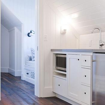 Washington School House Hotel - bedrooms - built-in bed nook, rustic wood floors, beadboard, beadboard backspalsh, white beadboard backsplash, microwave nook, modern faucet, mini-fridge, stainless steel mini-fridge, wet bar, bedroom wet bar, polished nickel, sloped ceiling,