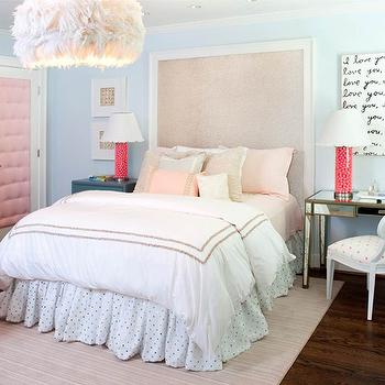 Kristin Peake Interiors - girl's rooms: metallic headboard, gum ball lamps, pink ball gum lamps, mirrored vanity, quatrefoil chair, white quatrefoil chair, feather chandelier, feather pendant, blue teen girls bedroom, tall headboard, pink tufted door, inset panel door, blue walls, blue paint, white desk, white desk shelves, turquoise blue and gray, office chair, pink piggy bank, cork board, bulletin board, cork bulletin board, red lamp, pink pillow, pink dots pillows, dots pillow, mismatched girls nightstands, girls paint colors, pink and blue girls bedrooms, taupe stitching,