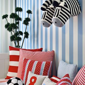 Ana Cordeiro - boy's rooms - stripe walls, red and blue, red gingham pillows, red stripe pillows, blue gingham pillows, soccer ball pillow, fabric zebra heads, wall-mount fabric zebra heads, red and blue boys bedrooms,