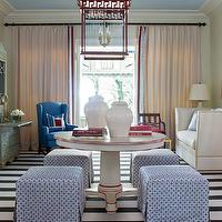 Tobi Fairley - living rooms - entryway living room, navy and white striped rug, red white and blue living room, red lantern pendant, painted blue ceiling, sky blue ceiling, entryway with pedestal table, blue and white skirted ottoman, Greek Key trim, pagoda style lantern, red lantern, white ginger jars, cream draperies, cream draperies with Greek Key trim, cream drapes with red and blue trim, white sofa, high sided white sofa, cobalt blue wingchair, cream pedestal table, foyer table, large entryway, large foyer, red trim, Tobi Fairley Marrakech, Hickory Chair, Tobi Fairley Rothesay Lantern, red lantern, pagoda lantern, red pagoda lantern,