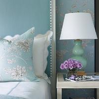 Tobi Fairley - bedrooms - turquoise blue bedrooms, turquoise blue headboards, turquoise blue headboard with nailhead trim, turquoise blue gray and white floral fabric, fabric wall treatment, turquoise blue, aqua blue, gourd lamp, aqua blue gourd lamp, cream nightstand, cream nightstand with shelf, cream nightstand with shelf and glass top, purple roses, ruffle edged pillow, ruffle edged pillow with blue piping, white hotel bedding with blue band, blue floral fabric, turquoise bedrooms, turquoise blue bedrooms, blue bedrooms, turquoise headboard,