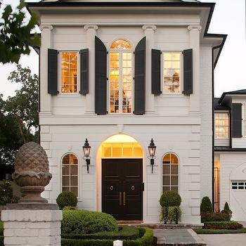 Michael J. Siller Interiors - home exteriors - black shutters, Greek columns, black doors, black entrance doors, black front doors, iron lanterns, iron lanterns flanking entry, arched windows, arch windows,