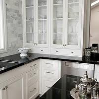 kitchens - absolute black granite, absolute granite countertops, black granite, polished granite countertops, glass-front cabinet, glass-front china cabinet, inset cabinets, ivory inset cabinets, marble subway tiles, marble subway tile backsplash, glass front kitchen cabinets, polished nickel hardware,