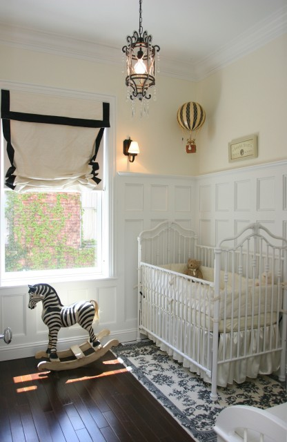 Space Architects & Planners - nurseries - vintage nursery, glam nursery, board and batten, board and batten walls, butter yellow, butter yellow walls, butter yellow paint, gender neutral nursery, roman shade, natural linen roman shade, black velvet, black velvet ribbon trim, ribbon trim, white crib, crib, vintage crib, white vintage crib, iron lantern, nursery lanterns, nursery lighting, rocking chair, zebra, zebra rocking chair, gender neutral nursery,