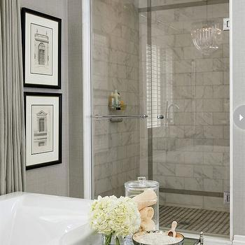 Style at Home - bathrooms - glass shower, seamless glass shower, calcutta marbles, calcutta marble shower, calcutta marble bathroom tiles, gray grasscloth, grasscloth wallpaper, gray grasscloth wallpaper, crown molding, millwork, soaking tub, modern soaking tub, etagere, bathroom etagere, mirrored etagere, mirrored bathroom etagere, nickel etagere, nickel bathroom etagere, grommet drapes, gray grommet drapes, bathroom chandeliers, marble tiles, marble bathroom floor, marble bathroom tile floor, gray bathroom,