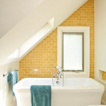 Renewal Design Build - bathrooms - yellow and blue, yellow and blue bathrooms, attic bathroom skylight, bathroom skylight, attic bathroom skylight, hex tiles, vintage hex tiles, hex bathroom floor, vintage hex bathroom floor, soaking tub, floor-mount tub filler, yellow bathrooms, yellow subway tile, yellow subway tile bathroom,