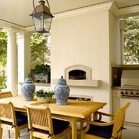 Sullivan Conard Architects - decks/patios - covered patio, pizza oven, outdoor pizza oven, BBQ, fireplace, outdoor fireplace, Greek columns, beadboard ceiling, Chinese ginger jars, ginger jars, teak furniture, teak dining table, teak dining chairs, cobalt blue, cobalt blue pillows, patio lanterns,