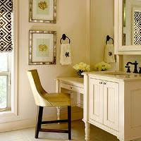 Tobi Fairley - bathrooms - cream bathroom, sink vanity, sink console, cream sink console, antique mirror framed art, mirror framed art, coral art, framed coral art, medicine cabinet, leather vanity chair, cream walls, tiled floors, cream tiled floors, porcelain tiled floors, brown and white roman blind, geometric blind, make-up desk, make-up vanity, turned wood, custom vanity, oil-rubbed bronze, oil-rubbed bronze faucet, oil-rubbed bronze towel ring, monogrammed towels, drop down vanity, drop down make up vanity, make up vanity, David Hicks La La Fiorentina Groundworks,