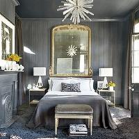 Architectural Digest - bedrooms - gray bedroom, chic gray bedrooms, textured walls, gray textured walls, gray ceiling metallic sheen, metallic sheen ceiling gray metallic sheen ceiling, gold mirror, gilt mirror, ornate mirror, gilt ornate mirror, gray blanket, gray bedding, charcoal gray, charcoal gray fireplace, gray rug, flokati rug, gray flokati rug, French ottoman, gray ottoman, velvet ottoman, gray French ottoman, gray velvet ottoman, gray French velvet ottoman, French velvet ottoman, gray French ottoman, zebra pillow, modern french bedrooms,