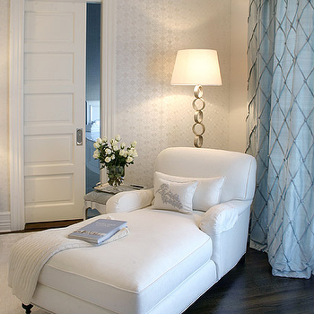 Elsa Soyars - bedrooms - bedroom corner, reading nook, bedroom seating, rolled arm chaise, chaise with nailhead trim, english rolled arm chaise, chenille rug, cream rug, castor feet, ring floor lamp, silver ring floor lamp, upholstered stool, silver tray, vase with roses, white pocket door, pocket door, pocket bathroom door, dark wood floors, subtle wallpaper, ivory patterned wallpaper, blue drapes, diamond pintuck stiching, blue diamond drapes, blue curtains, accent pillows, wool throw, chaise lounge, white chaise lounge,