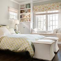 BHG - bedrooms - bedroom ottomans, tapered ottomans, storage ottomans, bedroom storage ottomans, ottomans nailhead trim, white ottomans, white tapered ottomans, white tapered storage ottomans, queen bed, blue and yellow bedding, blue and yellow, bedroom built-ins, bedroom built-in cabinets, bedroom cabinets, window seat, bedroom window seat, gray pillows, gray lattice pillows, lattice pillows, bedroom roman shade, floral roman shade, jug lamp, white jug lamp, white jug lamp, bookcase vignette,