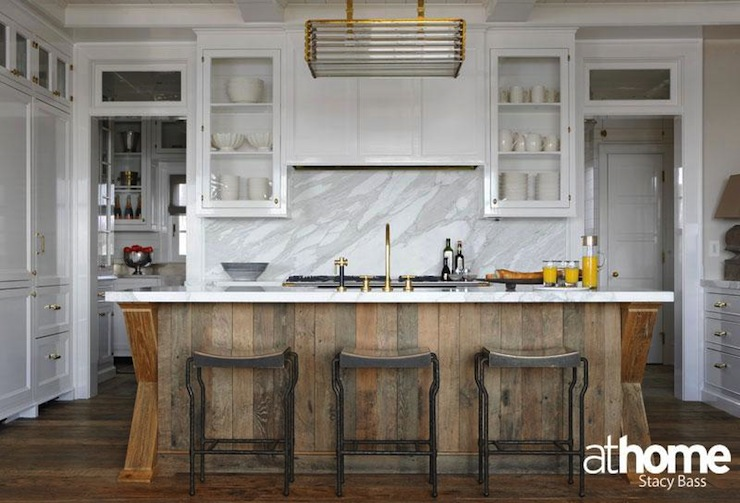 At Home in Fairfield County - kitchens - contemporary two-tone kitchen, salvage wood kitchen island, salvaged wood island, antique brass kitchen faucet, kitchen island sink, marble countertops, marble slab backsplash, marble slab kitchen backsplash, wood kitchen hood, glossy wood kitchen hood, wood refrigerator, glossy wood refrigerator, wood freezer, wood panel freezer, wood paneled freezer, transom windows, white shaker kitchen cabinets, modern brass lighting, modern brass chandelier, iron counter stools, modern iron counter stools,