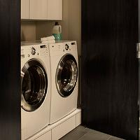 Paola Salinas - laundry/mud rooms - hidden laundry room, hidden washer and dryer, laundry room cabinet doors, white washer and dryer, front-load washer and dryer, white front-load washer and dryer, black laundry room cabinet doors, gray laundry room, white laundry room cabinet, white utility cabinets, slate tiles, slate tile floor, gray slate tiles, gray slate tiles floor, slate floor, gray slate floor, laundry room slate tiles, laundry room slate tile floor, laundry room gray slate tiles, laundry room slate floor,