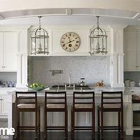 At Home in Fairfield County - kitchens - polished nickel lanterns, kitchen island lanterns, island lanterns, kitchen island, marble top kitchen island, drop-down cabinet, drop-down kitchen cabinet, butcher block top, butcher block countertops, butcher block drop-down cabinet, kitchen island sink, island sink, polished nickel bridge faucet, ivory kitchen cabinets, shaker cabinets, ivory shaker kitchen cabinets, mosaic tiles, mosaic tile backsplash, mosaic kitchen tiles, mosaic kitchen backsplash tiles, mosaic backsplash tiles, Large Round Edwardian Foyer Lantern,
