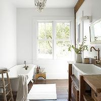 Country Living - bathrooms - chic country bathroom, wood plank floor, wood plank bathroom floor, claw foot tub, vintage claw foor tub, wood paneled wall, wood paneled bathroom wall, white porcelain bathroom sink, apron bathroom sink, bathroom apron sink, salvaged wood vanity, salvaged wood bathroom vanity, wall-mount faucet, wall-mount bathroom faucet, vintage wall-mount faucet, vintage wall-mount bathroom faucet, white washed, white washed mirror, white washed bathroom mirror, wicker baskets, wicker bathroom baskets, salvaged wood vanity, salvaged wood bathroom vanity, salvaged wood washstand,